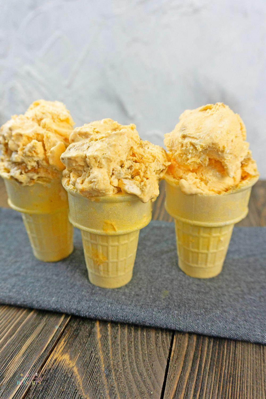 Close up image of pumpkin gingersnap ice cream in ice cream cones