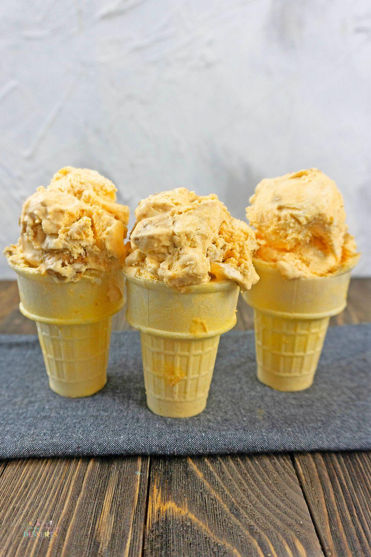 Pumpkin ice cream in three ice cream cones