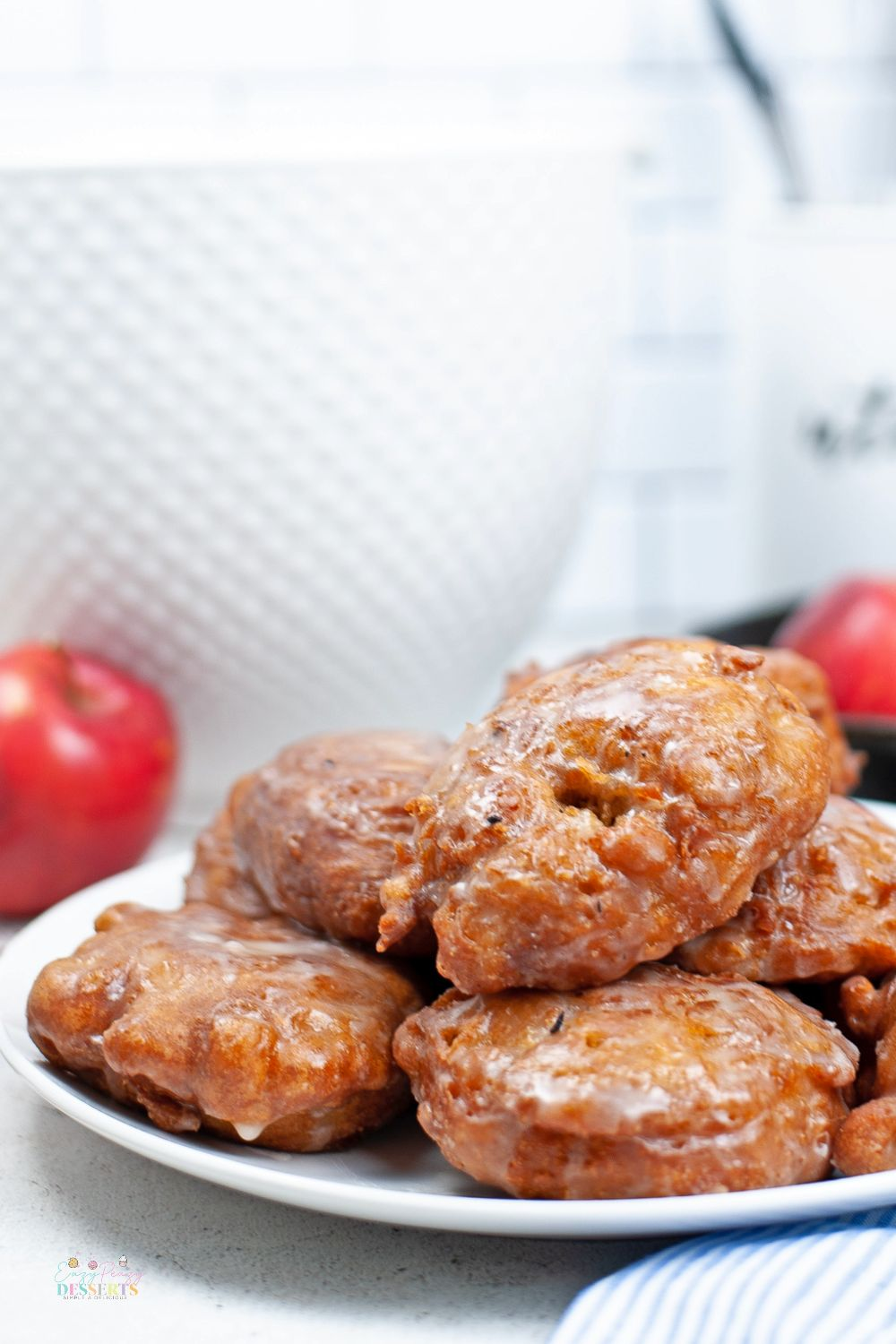 Close up image of apple fritters in a white serving plate